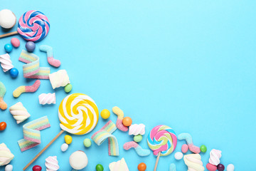 Sweet candies and lollipops on blue background