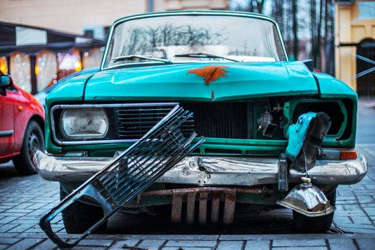 Old and rusty abandoned retro car closeup