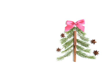 Christmas tree made of fir branches and golden decorations. Christmas, winter, new year concept.