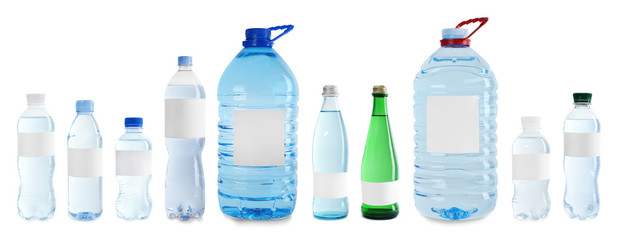 Set with different bottles of pure water on white background. Mockup for design