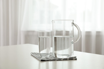 Glassware of fresh water on table indoors