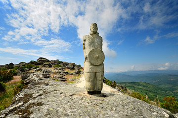A galician-lusitanian warrior watch the horizon on the top of the Iron Age settlement of Outeiro Lesenho at 1073m. Boticas, Tras os Montes. Portugal