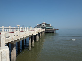 Wide angle image of the pier near the beach of Blankenberge.