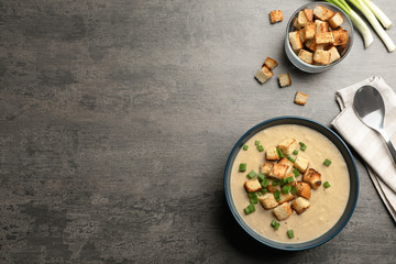 Bowl of fresh homemade mushroom soup on white background, top view