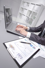 close up. businessman uses laptop to check financial data