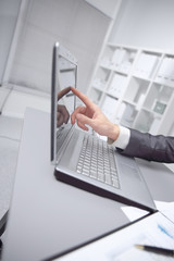 close up. businessman pointing at laptop screen