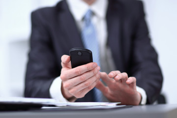 close up.businessman typing text message on smartphone