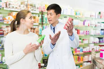 Joyful client asking pharmacist about medicines