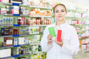 woman pharmacist  is standing with medicine