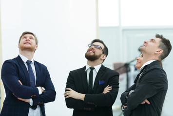 business team looking up at copy space.