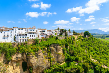 White houses on green hills in Ronda village in spring, Andalusia, Spain