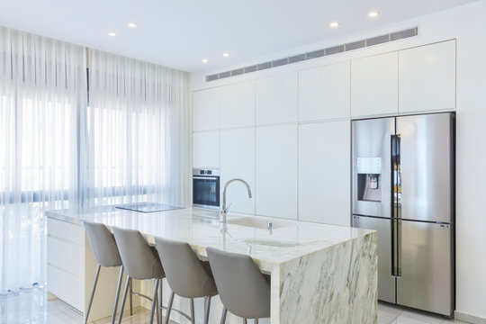 Luxury White Kitchen With Marble Island