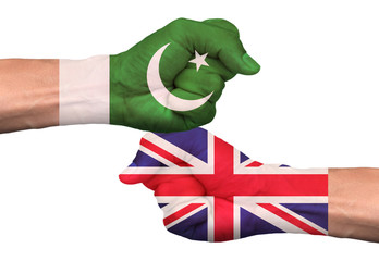 Front side fist of Pakistan and United Kingdom flags isolated on white background with clipping path