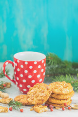 Christmas and New Year composition with delicious peanut cookies, peanuts and cup of coffee or tea