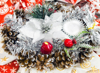 Christmas wreath of cones and fir branches with a small decorative stand. Beautiful Christmas background card.