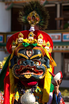 Unidentified monk performs a religious masked and costumed mystery dance of Tibetan Buddhism during the Cham Dance Festival in Gangtok, India