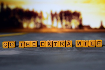 Go the extra mile on wooden blocks. Cross processed image with bokeh background