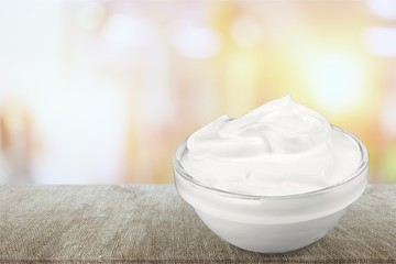close up of a white beauty cream or yogurt on white background