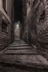 Medieval street that goes up narrow towards Bergamo Alta in the night