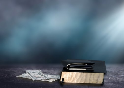 Holy Bible and money with Black wallet