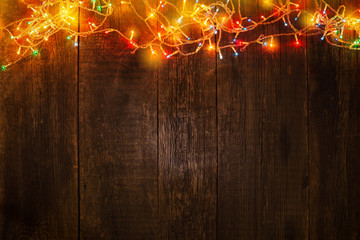 Christmas garland on wooden background