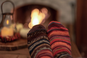 Relaxing by the fire in handknit socks