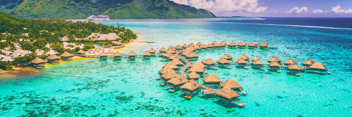 Papiers peints Océanie Travel vacation Tahiti hotel ocean beach paradise of overwater bungalows resort in coral reef lagoon ocean. View from above at sunset of Moorea, French Polynesia, Tahiti, South Pacific Ocean.