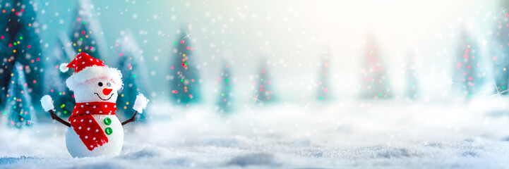 Happy Snowman In Winter Wonderland With Trees And Lights