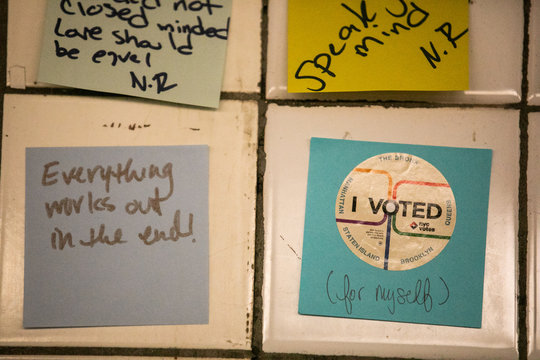 """A """"I voted"""" sticker is seen on a Post-it note displayed in the Union Sq subway station in New York City"""