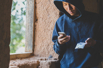 Drug dealers use the phone to contact the customer, drug trafficking, crime, addiction and sale, The concept of buying and selling drugs.