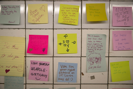 Messages written on Post-it notes are displayed in the Union Sq subway station in New York City
