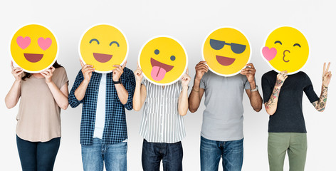 Diverse people holding happy emoticons Wall mural