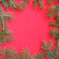 Christmas background with xmas tree on red canvas background. Merry christmas card. Winter holiday theme. Happy New Year.