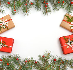 Christmas gift boxes decorated with craft paper and white snowflakes on red background top view. Merry christmas greeting card.