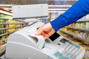 Fototapete - Cash register with LCD display and worker's hand holding receipt