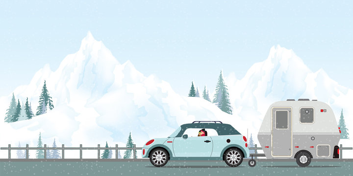 Happy couple driving car on road in winter.
