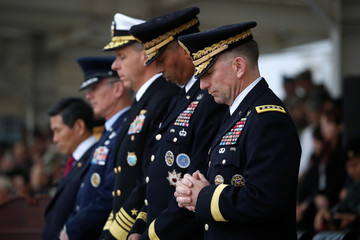 Incoming Commander, General Robert B. Abrams prays during a change of command ceremony for the United Nations Command, Combined Forces Command, and United States Forces Korea at the U.S. military base in Pyeongtaek