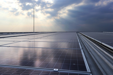 Solar PV Rooftop under Cloud with Sunlight Beam