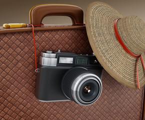 Vintage camera and women's hat hanging on suitcase. 3D illustration