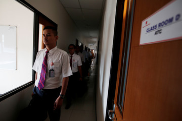 Aviation trainees of Lion Air Group leave the classroom after a training session at Angkasa Training Center near Jakarta
