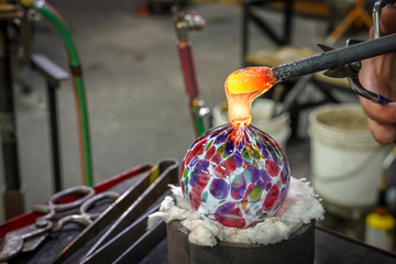 A Beautiful Glass Ball Being Made by a Glass Blower