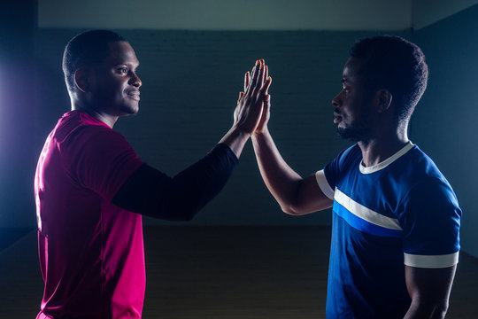 team work two handsome african american sportsman in boxing on a black background in the gym,trainer and ward practicing boxing
