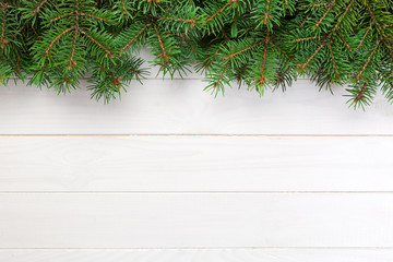 Christmas wooden background with fir tree and copy space. top view empty space for your design