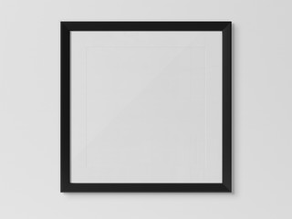 Black squared frame hanging on a white wall mockup 3D rendering