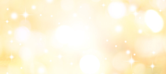 abstract blur glowing gold yellow color background with bokeh ,snow and shine star for merry...
