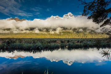 Mirror Lakes with reflection of Earl Mountains, Fjordland National Park, Millford, New Zealand