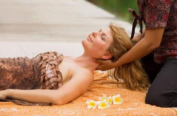 Woman enjoying relaxing neck massage