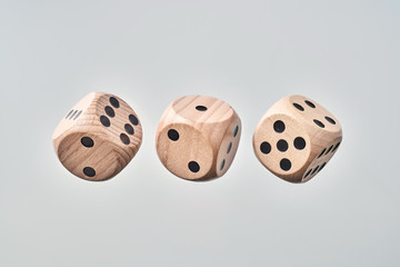 Abstract floating wooden dice on white background