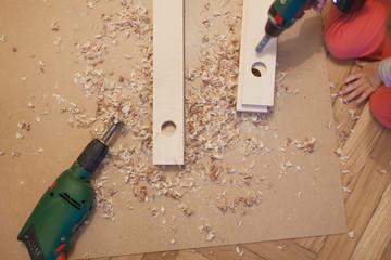 Child learn with tool at woodwork. Kind lernt Holzarbeit mit Werkzeug.