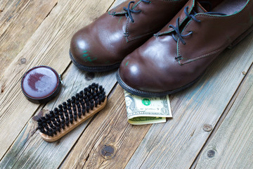 boots, brush, shoe polish and dollar